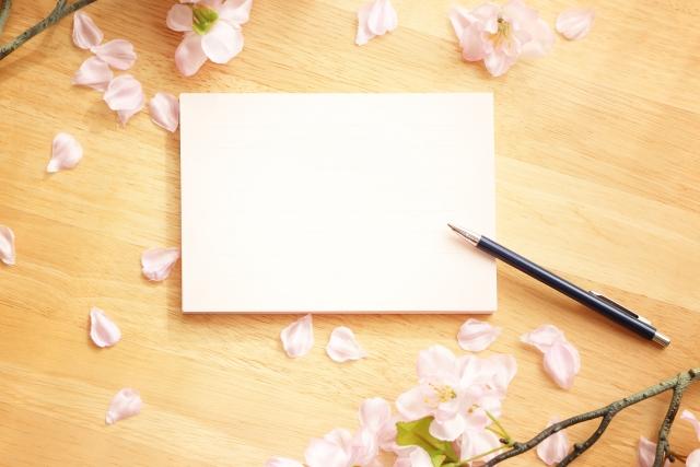 桜とノートとペンの写真
