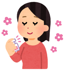 香水をつける女性のイラスト